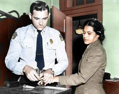 The police officer looks embarrassed...as he should! Mrs. Rosa Parks.