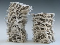 """Chain Reaction; Sculpture.  (22 x 9 x 8"""", 18 x 8 x 8"""") Hand-built. Thin torn sheets stacked with thousands of cubes.  Glazed, Fired.  Early work. Katherine Dube 2000-2013."""