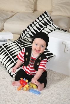 Baby Buccaneer Pirate Dress up Costume - www.totswarehouse.com  The Dress up By Design Baby Buccaneer dress up outfit is perfect for any aspiring pirate.  The outfit includes:      Red and white striped cotton jersey t-shirt with skull and cross bone print to front.     Black Mock waistcoat     Soft Cotton Black hat     Polyester Jagged cut trousers     Machine washable  #baby #pirate