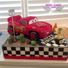 Lightning McQueen Cars Cake - Lightning McQueen Birthday Cake.  Car is all cake, tires are modeling chocolate.