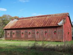 Old red barn with Christmas wreaths
