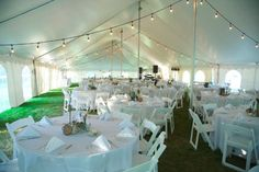 Tented outdoor wedding reception idea - string lights, round tables with white linens and folding chairs {Kirk Hoffman Photography}