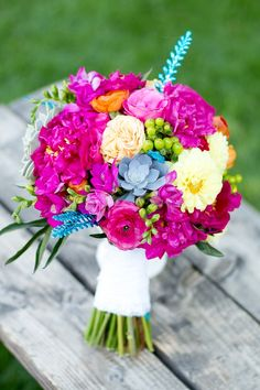From wedding florist Three Leaf Floral. Turquoise hues, warm oranges and vibrant fuchsia peonies played wonderfully off the breathtaking location at Two Rivers Winery and Chateau, at the base of Colorado's National Monument in western Colorado.