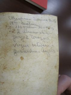 A note from a bookseller (I presume) indicating the qualities of the item. According to this, it was produced in the 1800s. Also on this page, the nature of the animal skin is apparent.