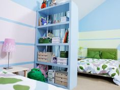 Use open shelving and a creative paint technique to create an individual space for each kid in a shared room.