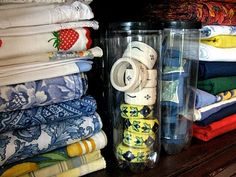 Table Linen Storage - napkin rings are stored in tennis ball containers! (see other pics)