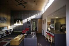 Light streams through the clerestory window into the living area of Haberfield House