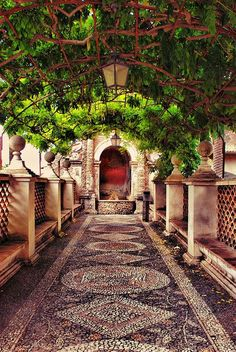 A Path at the Villa d'Este in Tivoli, Italy.   With its…
