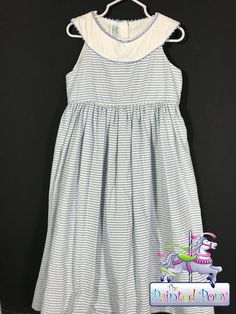 Peaches 'n Cream girls dress, fits size 6 - 7, in soft blue and white stripes. $19.99
