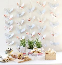 Make some pretty butterfly origami garlands and tea treats for Mom's Day. Photo by Janis Nicolay