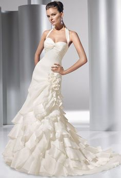 Brides: Demetrios - Illusions. Satin organza halter gown with sweetheart neckline and empire bodice. Multi-ruffled skirt.
