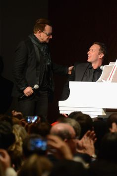 Bono from U2 and Chris Martin from Coldplay at Jony & Marc's (RED) Auction Sotheby's New York City November 23, 2013.