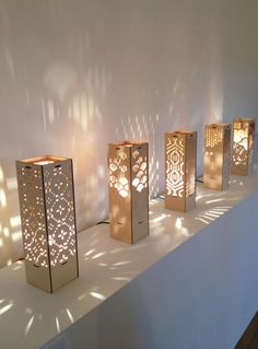 Drws Y Coed - light , table lamp, perforations Lighting designed by Hannah Wardle