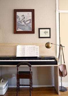 DIY plywood piano stand doubles as a desk when the top flips down!