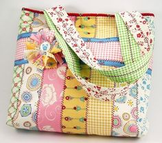 This is a tote bag I designed using a Baskets of Flowers Jelly Roll by Mary Engelbreit. It has 2 inside pockets, a quilted lining and magnetic snap closure. There is decorative stitching between...