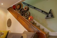 I've been wondering how to make my basement stairs funkified - now I know! repurposed sign and industrial found objects