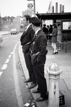 A London Transport bus crew seen waiting at the Beresford Square bus stop, June 1971.