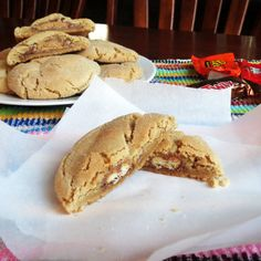 Peanut Butter Peek-a-boo Cookies- a soft peanut butter cookie with the Halloween candy bar of your choice inside.  SO YUMMY and a great way to use up your Halloween candy.