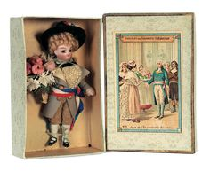 boy is wearing his original formal court wear including lace jabot,French silk sash,short trousers,formal grey greatcoat,hat,and is carrying a large bouquet of flowers for the bride. The doll is preserved,impeccably,in his original box,he appears costumed as the young family member attending the wedding couple. French,circa 1890.