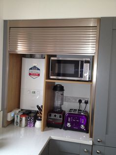 Appliance garage with tambour door.