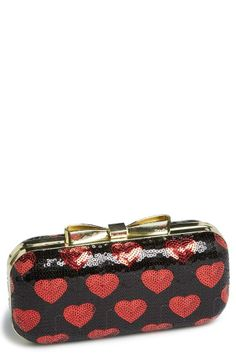 Pairing this sequin clutch with red hot pumps!