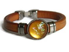 Brown silver orange leather bracelet boho chic by TheRottenRooster,