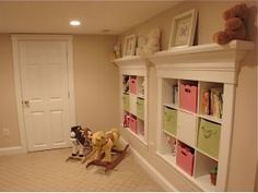 Built ins for the basement playroom - Love the shelf on top. #home #decor