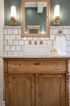 Gorgeous old world art deco bathroom reno by Erin Napier. I'm in love with the white and grey marble tile, the grey grout, the lush green walls, the brass, the wood... everything!