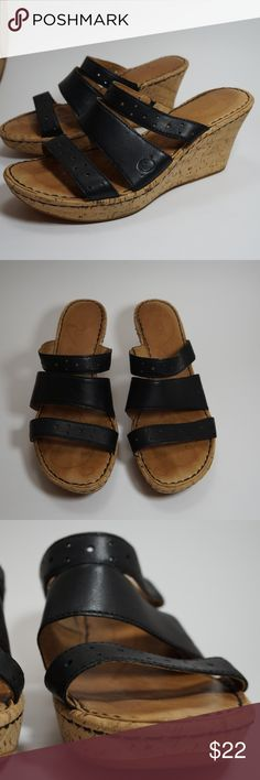 Born cork wedge triple strap sandal 7 Beautiful gently used Born sandals. 3 black leather straps with cute small circular cut-outs. Cork style wedge heel. Size 7. Born Shoes Wedges