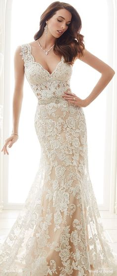 Lace over stretch jersey fit and flare gown scattered with sequins features slight cap sleeves, scalloped deep V-neckline, illusion and scalloped lace back features zipper trimmed with diamante buttons, hand-beaded belt attached at natural waist, scalloped hemline, court train.