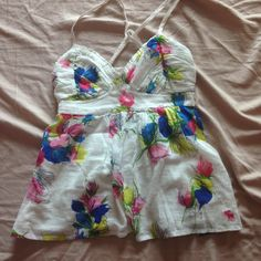 Abercrombie open back tank top Cute white floral tank top with an open fly away back. Has only been worn a couple times and has no flaws. Size XL in kids fits an XS. Baby doll fit and very light weight. Abercrombie & Fitch Tops Tank Tops