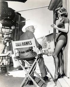 Howard Hawks and Angie Dickinson on the set of Rio Bravo, 1959