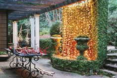 Hang twinkling Christmas lights on a fountain or stone wall in the garden to create a striking winter focal point from your patio or porch. Even if it's too cold to entertain outside, you''ll enjoy the soft cozy glow through the windows.
