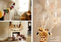 Pom pom garland decor and confetti filled clear balloons. Animal themed first and third birthday party.