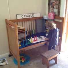 Cute re-use of a child's crib. Turn it into a desk or play space. GREAT idea!