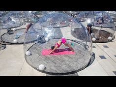Yoga class uses see-through domes to keep students safe - YouTube