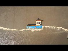 Charming video set on a beach transformed into the world's largest stop motion animation set.