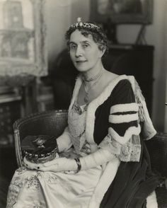 A delicate belle epoque diamond star tiara, worn by May Fairlie, Viscountess Harberton, taken May 1937. Designed as a trio of diamond stars, which probably doubled as brooches, attached to a foliate scrolling base.