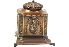 """Copper inkwell with Empire-style decoration. Inkwell has a glass insert and hinged lid. Lid is broken from hinge pin, but can be repaired and is still usable. Marked: """"JB 1622"""" underneath."""