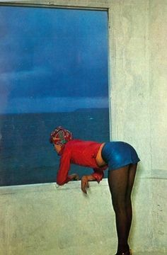 Photo by Guy Bourdin, 1971. S)    I'm curious about what she is looking at...