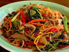 Japchae 잡채 Japchae, sweet potato starchnoodles stir fried with vegetables and meat, is one of Korea's best-loved dishes,