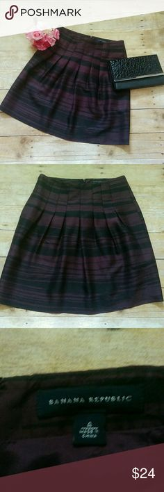 100% Silk Banana Republic Striped Skirt Size 4 This listing is for a beautiful silk skirt by Banana Republic. It is black and plum striped and is a size 4. It is 100% silk. It is in excellent condition with no flaws.  #360 Banana Republic Skirts