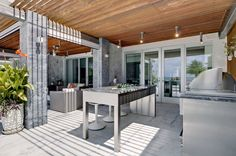 Killer High Top Table home interior design Contemporary Patio Miami home loans BBQ CEILING LIGHT columns counter stools covered covered grill glass doors hardscape island marble floor outdoor dining outdoor furniture planter potted plant sitting area wood slat ceiling - Decorcology.com