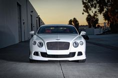 White Bentley Gt (coupe) with Wine Colored Interior  - the kind of car I'm getting in the early part of  2015
