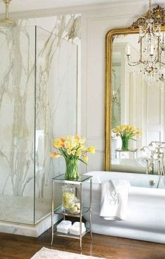 similar to my layout. Love the gold mirror behind the tub with the marble in the shower. Wood floors are interesting and pretty