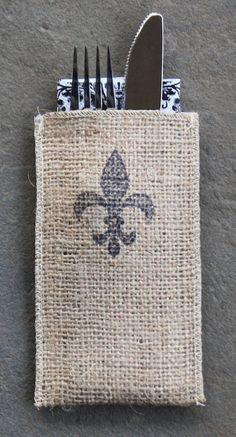 Add European panache to your table with our fleur de lis silverware pouches stamped with the french symbol of hospitality. Pair it with a toile napkin for a conventional look or a vibrant pattern for Burlap Projects, Burlap Crafts, French Symbols, Sewing Crafts, Sewing Projects, Eagle Scout, Burlap Flowers, Christmas Mom, Felt Fabric