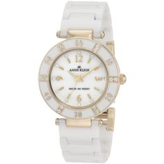 Anne Klein Women's 109416WTWT Swarovski Crystals Gold-Tone White Ceramic Swarovski Crystal Accented Watch  75.87 #anne klein #anne klein watches #anne klein crystal watch  Modern luxury. This is the must-have dress watch. Lustrous, white all ceramic links are paired with a simple, round silvertone case. The coordinating bezel features clear, Swarovski crystals set in six stations. A white, genuine mother-of-pearl dial highlights and additional 12 crystals marking hours.