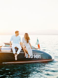 Romantic engagement session on a boat! Hair + Make Up: The Hair And Makeup Atelier - http://www.stylemepretty.com/portfolio/the-hair-and-makeup-atelier Photography: André Teixeira, Brancoprata - www.brancoprata.com/ Read More on SMP: http://www.stylemepretty.com/destination-weddings/italy-weddings/2017/02/15/romantic-italian-engagement-session/