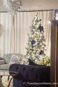 I love these blue, white and gold Christmas tree decor ideas. The garland over the fireplace mantle is a beautiful holiday decoration, too.
