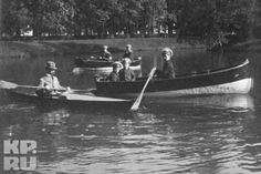 Tsarevich Alexei Nikolaevich Romanov of Russia rowing on the lake in the grounds of the Alexander Palace.In the boat with him are the two elder sons of Andrei Deverenko,his sailor nanny.In the kayak is Pierre Gilliard and Deverenko is in the rowboat at the back of the photo.Photo was taken in 1914.A♥W